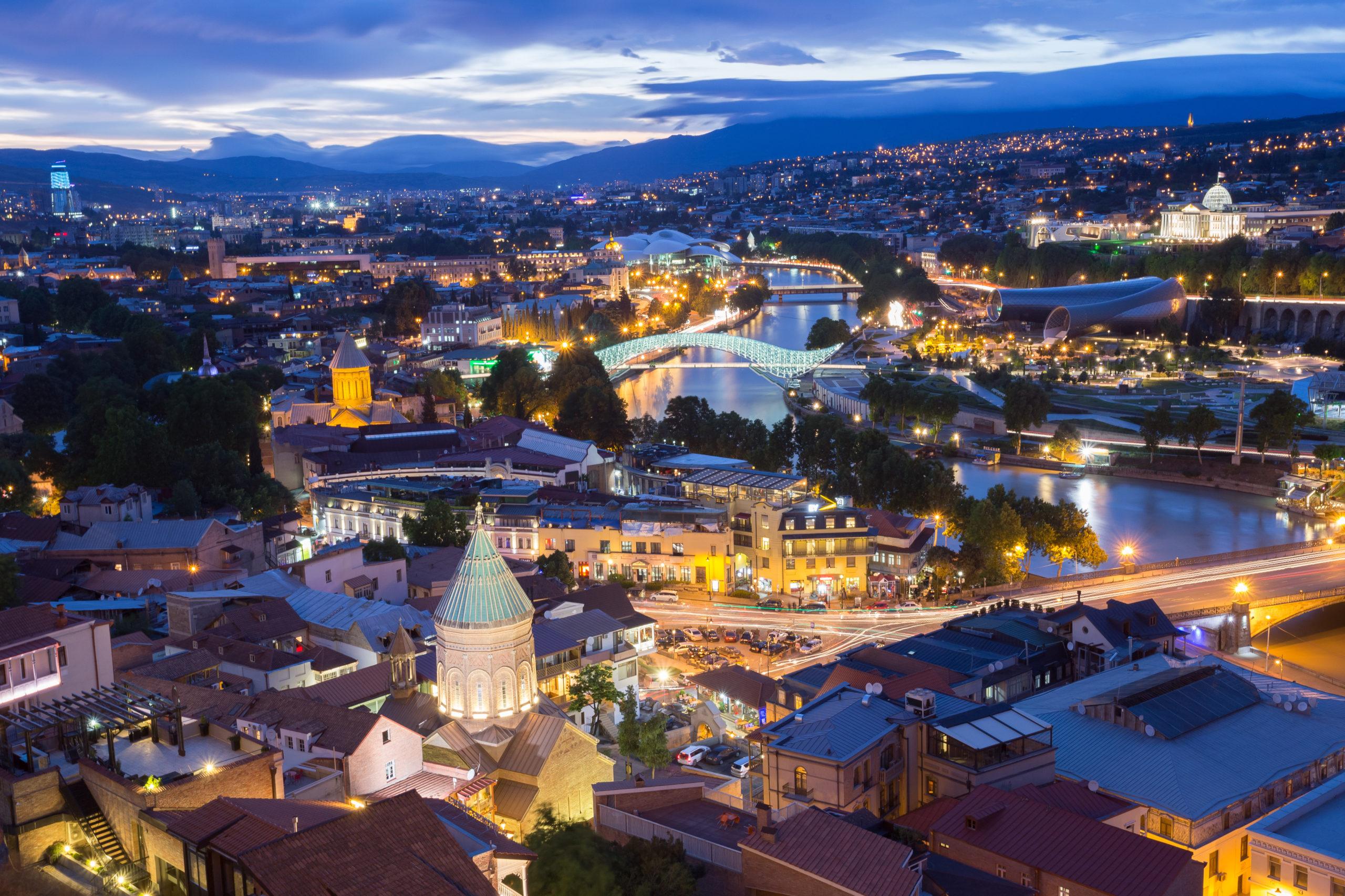 Tbilisi In evening light. Metekhi Bridge, Surb Gevorg Church and other famous landmarks.
